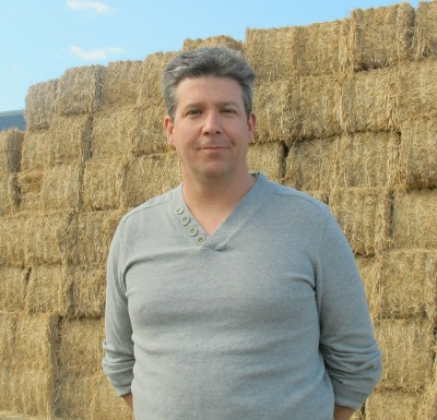 4979_dean_tiessen_in_front_of_baled_miscanthus